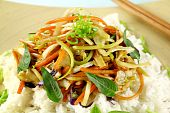 picture of vegetarian meal  - Delicious vegetarian asian stir fry on boiled white rice with thai basil and vietnamese mint - JPG