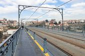 picture of dom  - Subway railway tracks and electric cables on the superior deck of the Dom Luis I bridge connecting Vila Nova de Gaia to the city of Porto - JPG