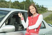 picture of driver  - Car driver woman happy showing car keys out window - JPG