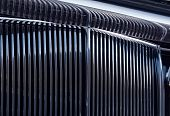 foto of luxury cars  - Shiny chromed front radiator grill of classic luxury car - JPG