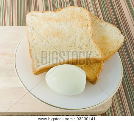 Brown Toast With Boiled Eggs In A Dish