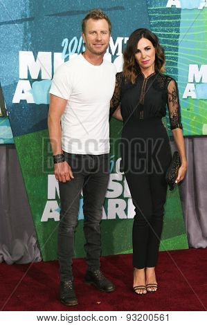 NASHVILLE, TN-JUN 10: Singer Dierks Bentley (L) and wife Cassidy Black attend the 2015 CMT Music Awards at the Bridgestone Arena on June 10, 2015 in Nashville, Tennessee.
