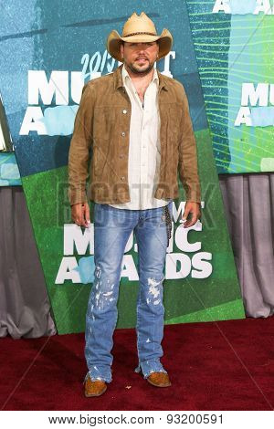 NASHVILLE, TN-JUN 10: Singer Jason Aldean attends the 2015 CMT Music Awards at the Bridgestone Arena on June 10, 2015 in Nashville, Tennessee.