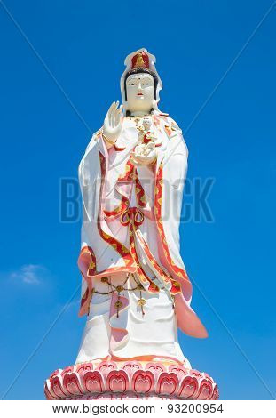 Statue Of The Goddess Guanyin On Blue Sky