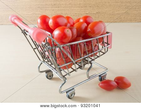 Fresh Grape Tomatoes On A Small Shopping Cart