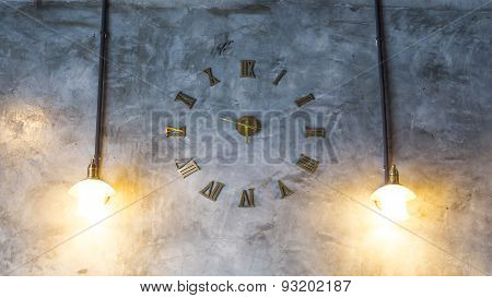 Cement Wall With Vintage Clock And Light Bulbs
