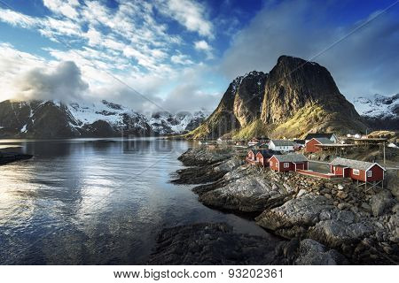 Fishing hut at spring sunset - Reine, Lofoten islands, Norway