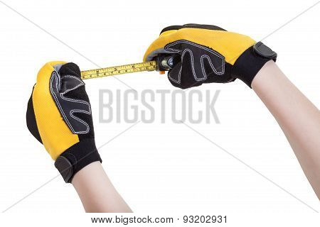 Builder Hands In Safety Glowes With Measuring Tape