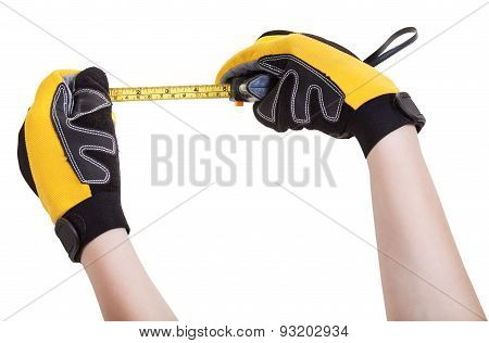 Hands In Protective Glowes With Tape Measure