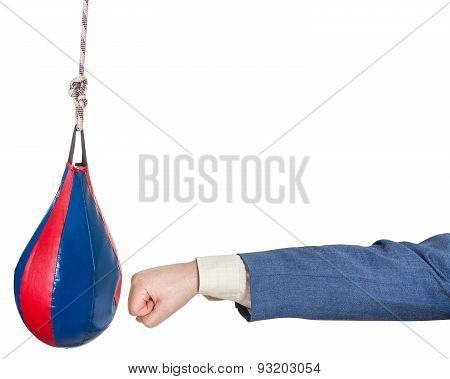 Man In Office Suit Punches Punching Bag Isolated