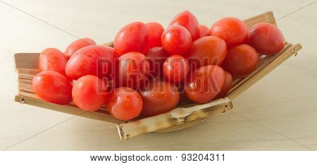 Delicious Fresh Red Tomatoes On Small Boat