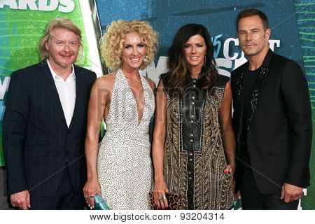 NASHVILLE, TN-JUN 10: (L-R) Phillip Sweet, Kimberly Schlapman, Karen Fairchild & Jimi Westwood of Little Big Town attend the 2015 CMT Music Awards at Bridgestone Arena on June 10, 2015 in Nashville.