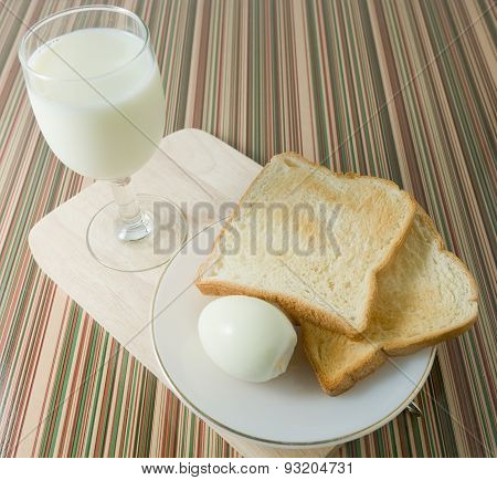 Brown Toast With Boiled Eggs And Milk