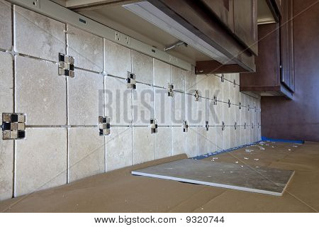Installation of New Tile Backsplash
