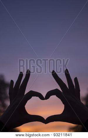 Heart Shape Hands At Dusk Silhouette Sunset Sky