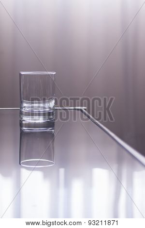 Glass Of Water On Table In Window Light Effect