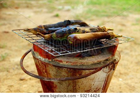 Grilled eggplants on earthen stove