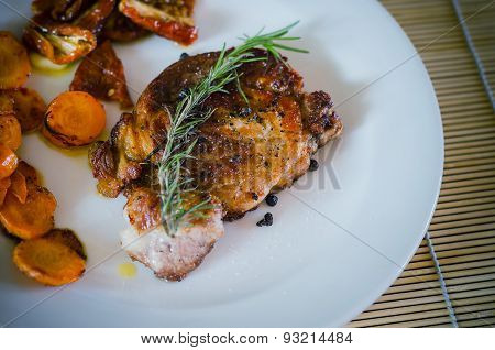 Pork Steak With Roasted Carrots And Dried Tomatoes