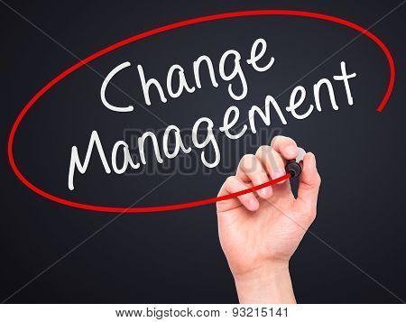 Man hand writing Change Management on visual screen.