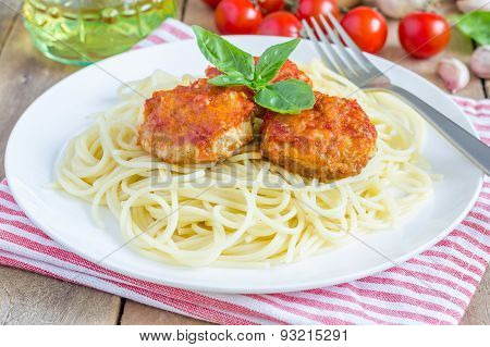 Meatballs In Tomato Sauce With Spaghetti On A White Plate