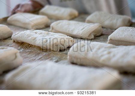 Baker Holding Tray Of Ciabatta Bread Rolls