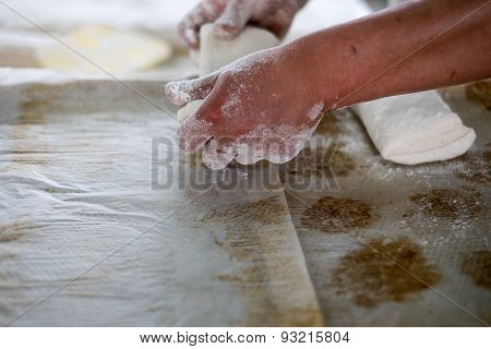 Baker Pulling Raw Ciabatta Bread Dough