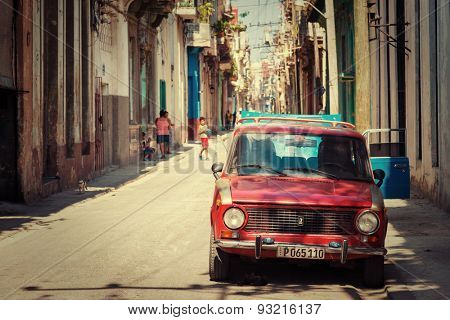 HAVANA,CUBA - MAY 30,2015 : Old russian car on a typical neighborhood with decaying buildings in Old Havana