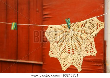 Beautiful Handmade Knitted Serviette Hand On The Rope With Clothespin On The Orange Wall Country Hou