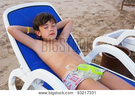 Preteen Handsome Boy Lay On The Beach With Snirkeling Mask  Get Sun Tan