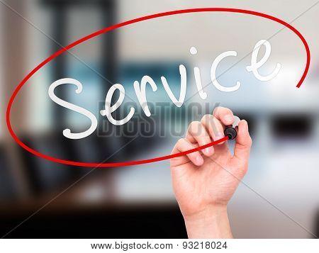 Man hand writing Service on visual screen.