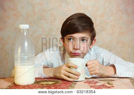 Cute Preteen Handsome Boy Drink Milk From Mug