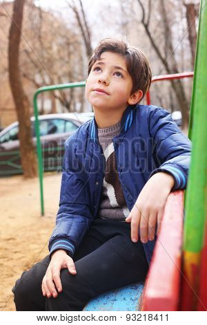Handsome Preteen Boy Expressive Thoughtfull Portrait On The Playground