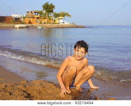 Preteen Handsome Boy Swimming On The Red Sea Beach And Yaht Background