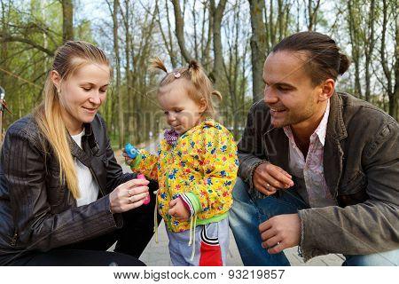 Happy Parents With Daughter Outdoor