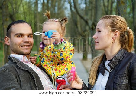 Happy Parents With Daughter Outdoor