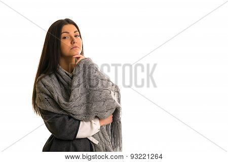 A Girl In A Gray Knitted Scarf Thinking.