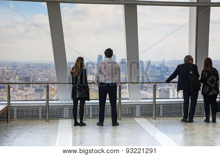 LONDON, UK - APRIL 22, 2015: People looking at the London's skyline. Viewing platform of Walkie-Talk