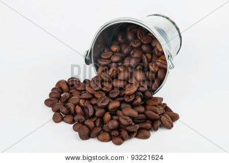 Coffee Beans Spilling Out Of Bucket