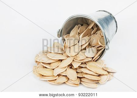 Pumpkin Seeds Spilling Out Of Bucket