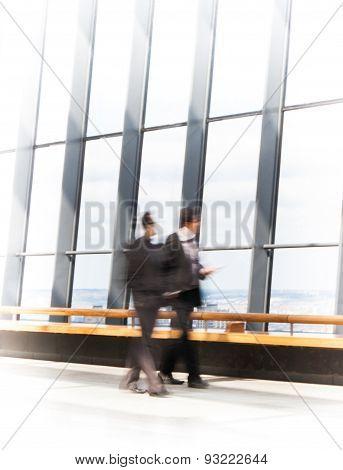 LONDON, UK - APRIL 22, 2015: Business people walking in hall of Walkie-Talkie building