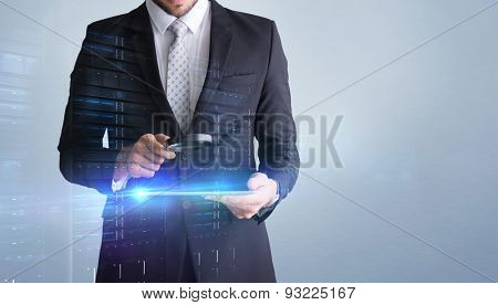 Concentrated businessman using magnifying glass against grey vignette