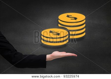 Businesswomans hand presenting against black wall