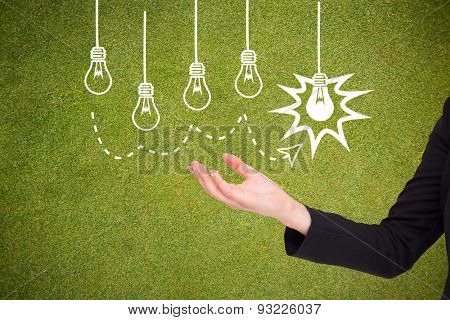 Businesswomans arm presenting against green background