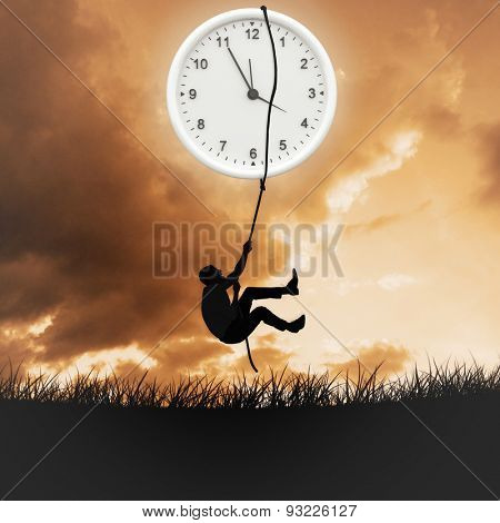 Businessman pulling a rope against cloudy sky