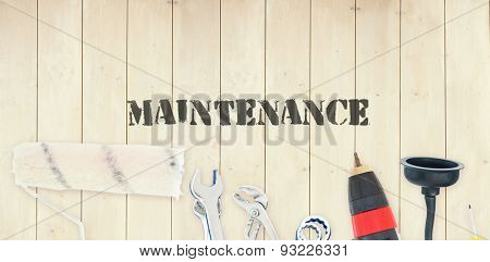 The word maintenance against diy tools on wooden background