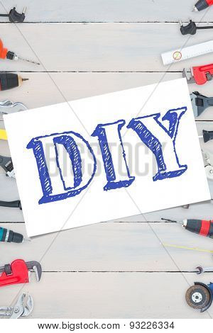 The word diy and white card against tools on wooden background