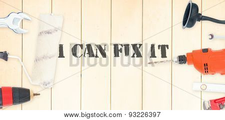 The word i can fix it against diy tools on wooden background