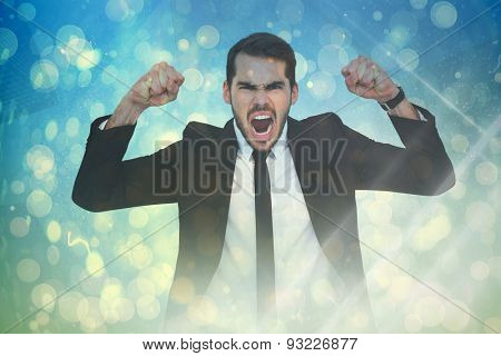 Furious businessman tensing arms muscle against blue abstract light spot design