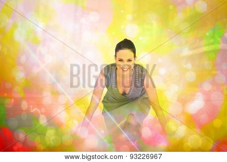 Smiling gorgeous woman getting ready for departure against girly pink and yellow pattern