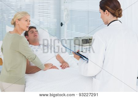 Doctor talking with her patients mother in hospital room
